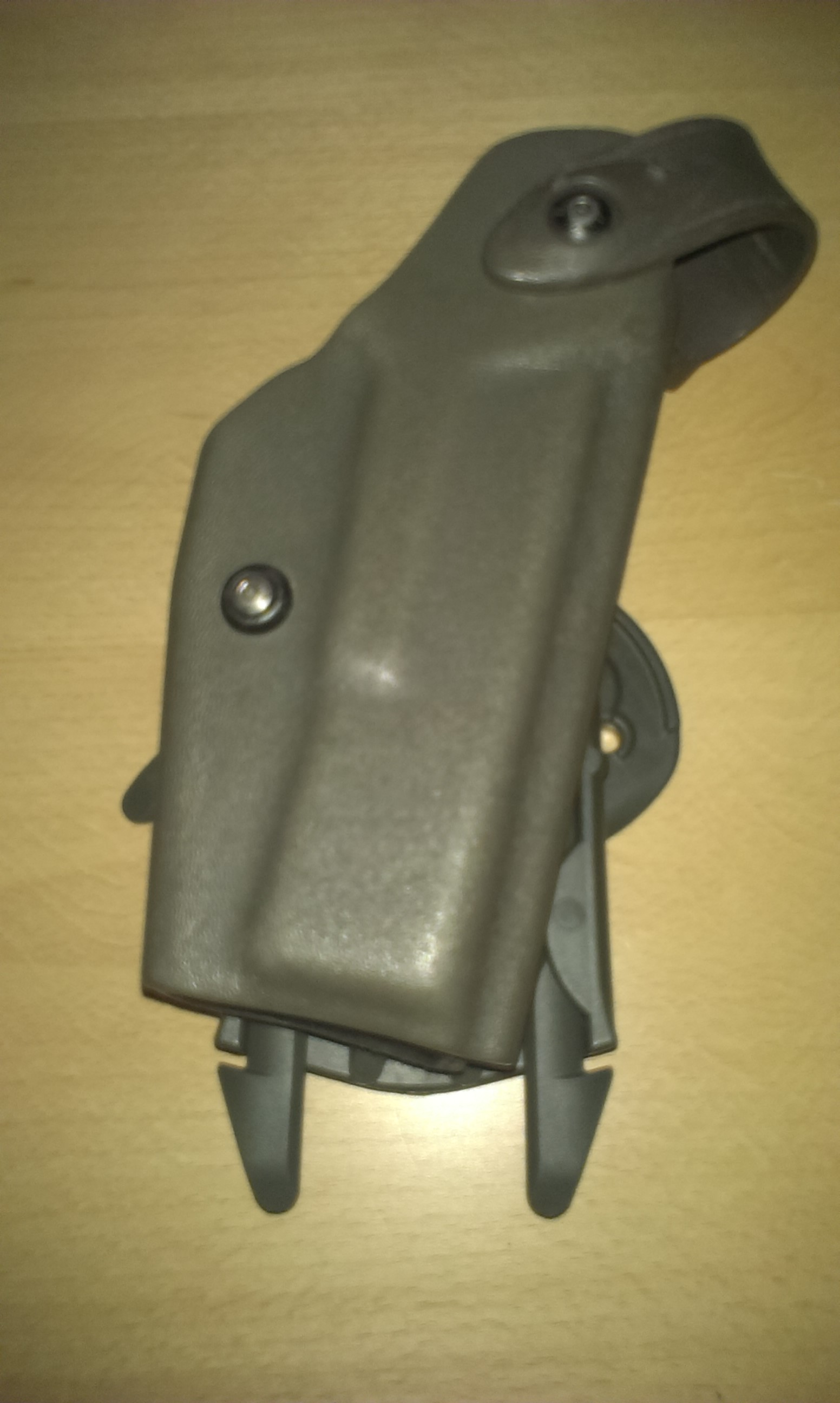 Holster inserted in vest assembly from the front.