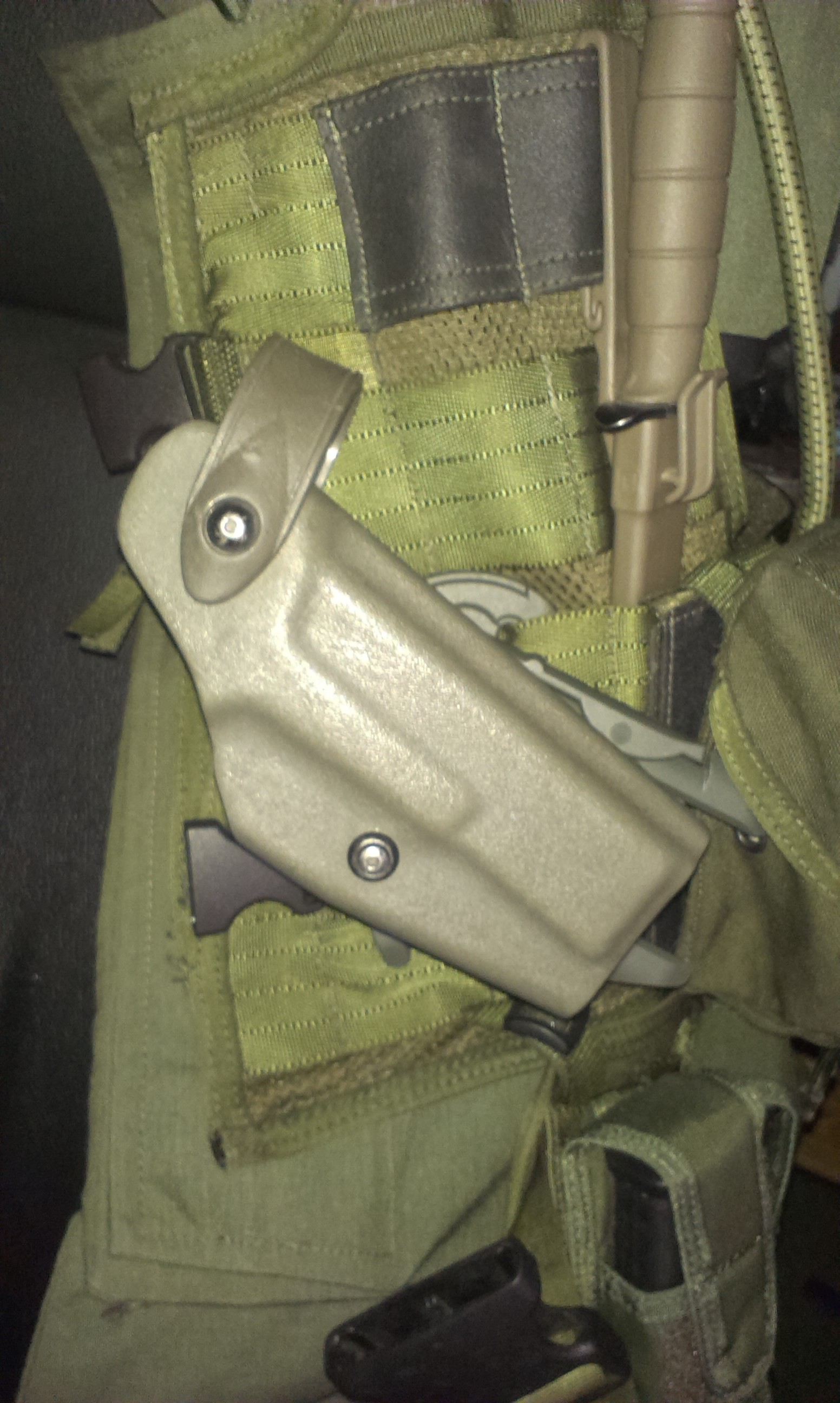Holster attached in vest assembly